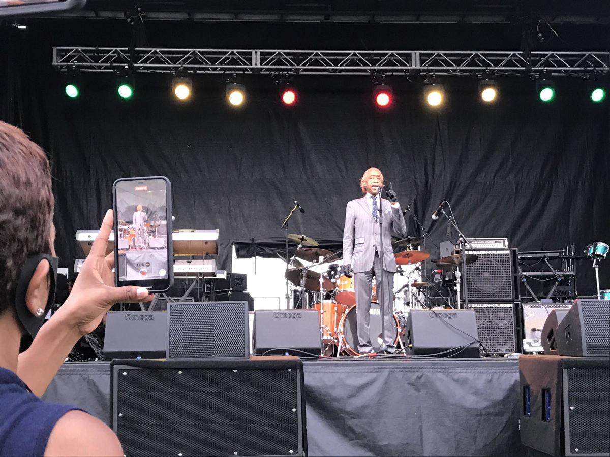 The Rev. Al Sharpton speaks to the crowd at a Juneteenth celebration in the Greenwood District of Tulsa on Friday, June, 19, the evening before President Trump's rally nearby at the BOK Center downtown. (Photo by Graham Lee Brewer)