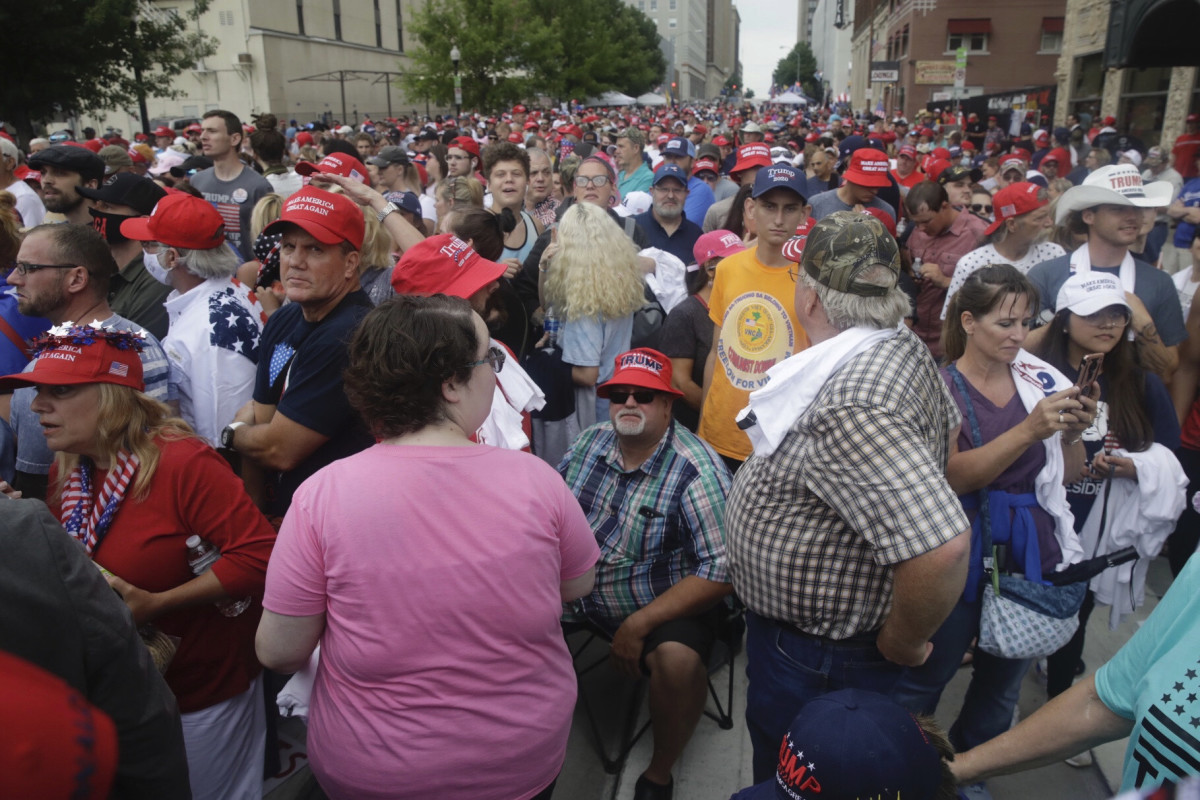 People wait in downtown Tulsa, Okla., to enter President Donald Trump's campaign rally on Saturday, June 20, 2020. (Mike Simons/Tulsa World via AP)