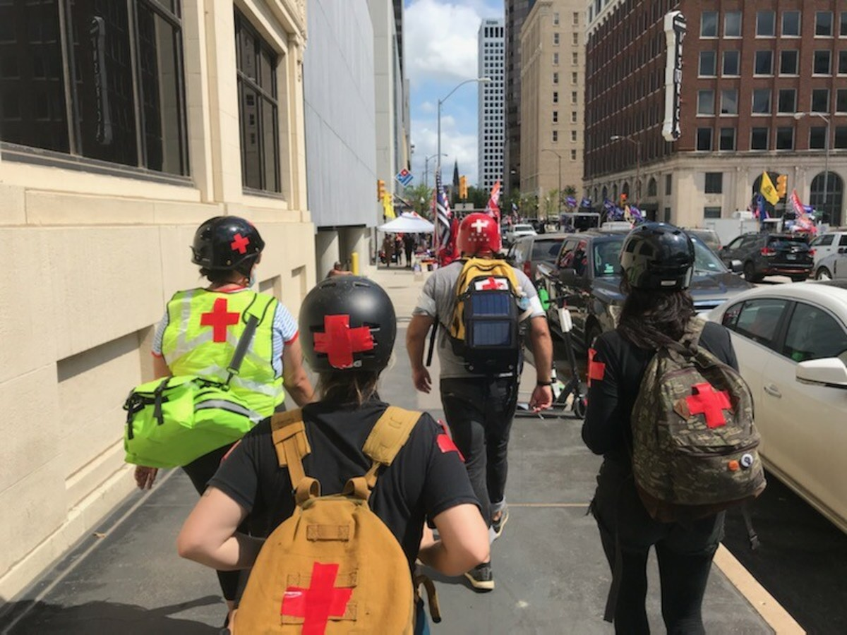 A group of medical professionals heads toward the 19,000-seat BOK Center in downtown Tulsa, Oklahoma, on Saturday. (Photo by Graham Lee Brewer)