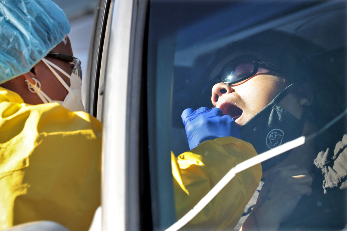 People get tested for COVID-19 at a drive through testing site hosted by the Puente Movement migrant justice organization Saturday, June 20, 2020, in Phoenix. (AP Photo/Matt York)