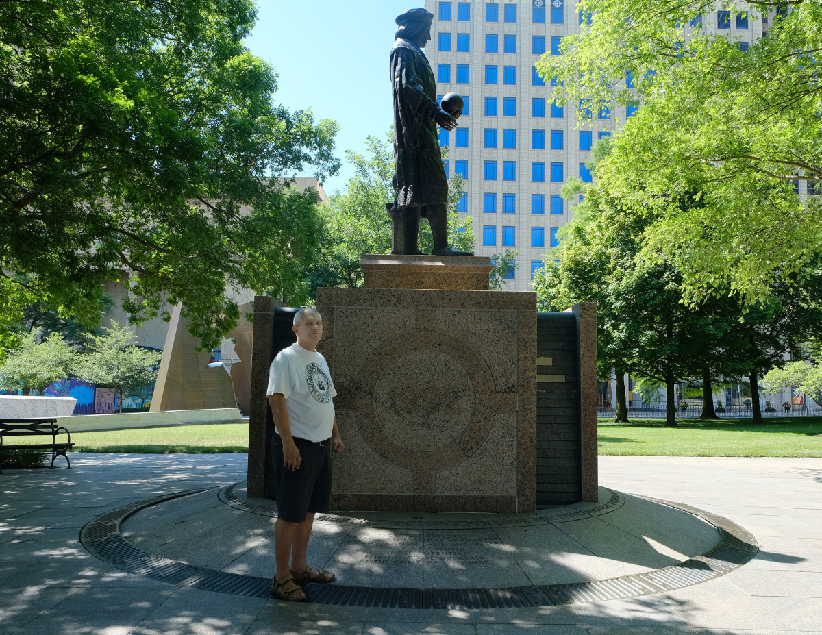 Mark Stansberry on the Ohio Statehouse lawn in Columbus where a statue of Christopher Columbus also stands. The fate of this memorial will be decided July 16. Photo by Mary Annette Pember