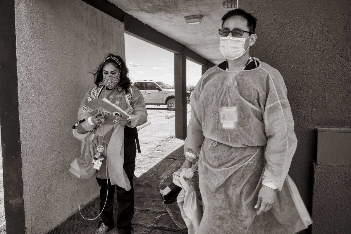 Shaniya Wood and Dr. Caleb Lauber after a long day of checking on patients who have COVID-19 or might be infected. (Photo by Don J. Usner, Searchlight New Mexico)