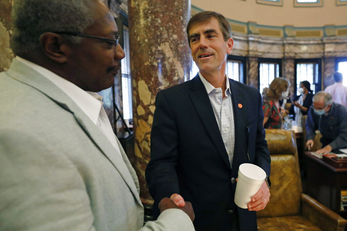 Republican Sen. Briggs Hopson, of Vicksburg, right, is congratulated by Sen. John Horhn, D-Jackson, for successfully navigating a resolution to suspend the rules and vote to change the state flag Saturday, June 27, 2020, at the Capitol in Jackson, Miss. (AP Photo/Rogelio V. Solis)