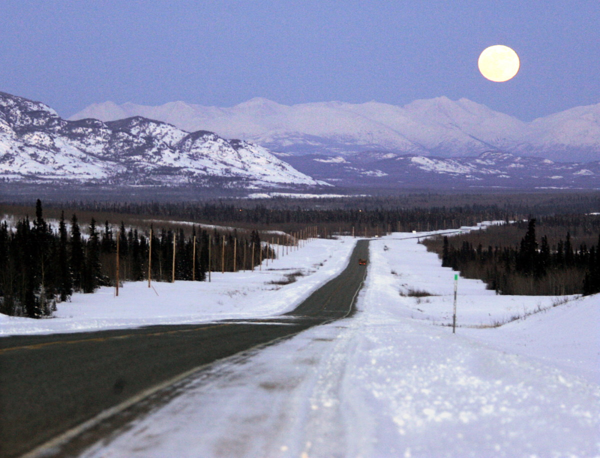 Moon rises over mountains along the Alaska Highway in the Yukon Sunday March 4, 2007. The Yukon covers an area of 483,450 sq. km. containing a population of 30,469. (AP Photo/Chuck Stoody, File)