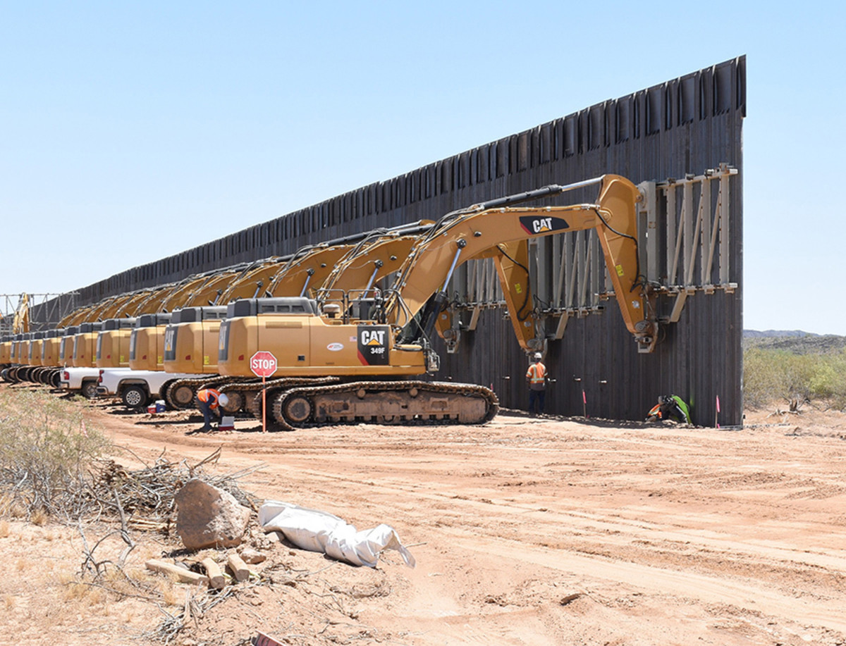 A row of excavators forms an assembly line during U.S. Army Corps of Engineers work on the border wall near Yuma in May. A federal court ruled Friday that the Trump administration's use of Pentagon funds for border wall construction is unlawful. (Photo by Robert DeDeaux/U.S. Army Corps of Engineers)