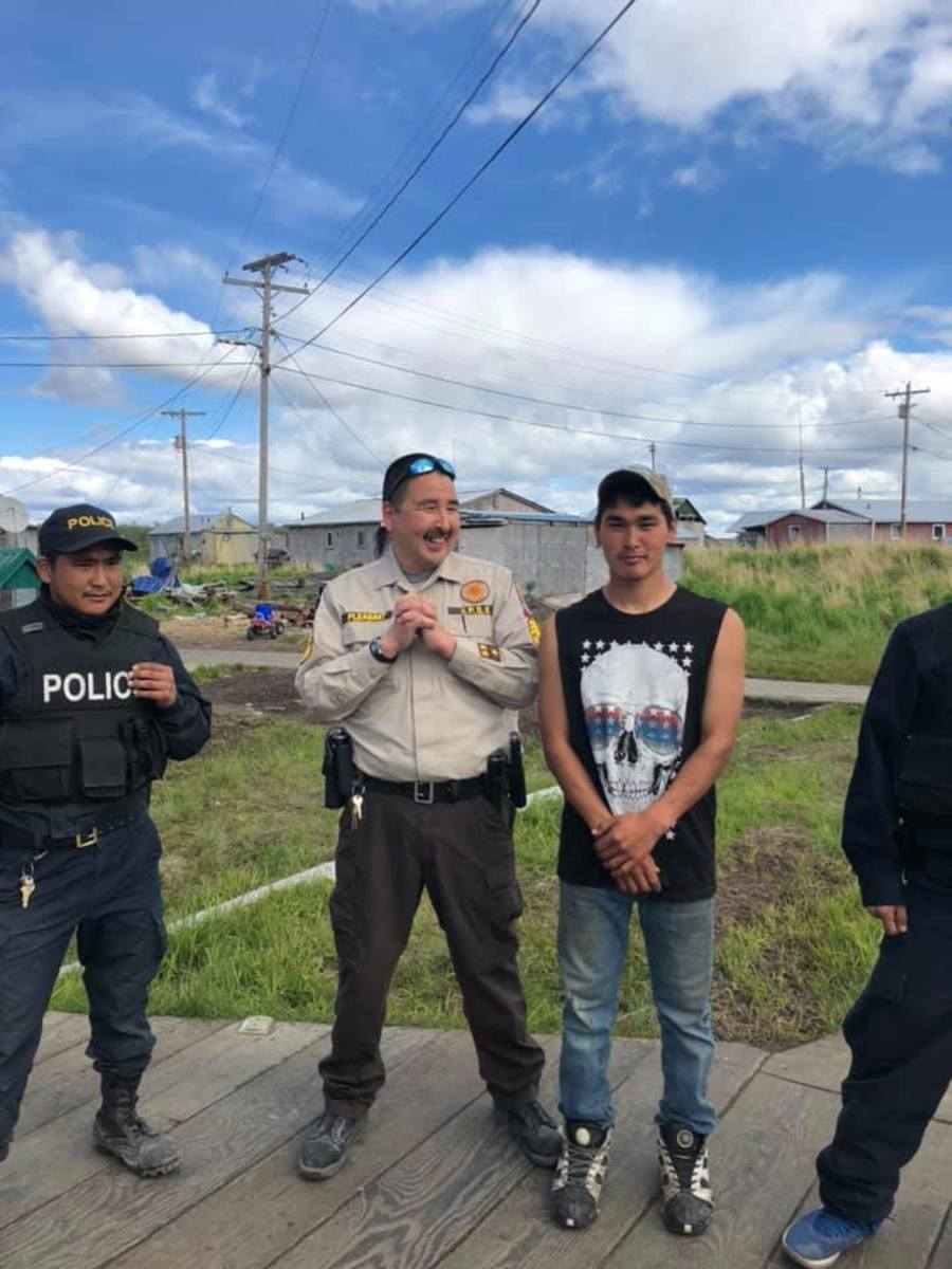 From left to right, an unidentified police officer, Village Public Safety Officer John Pleasant, and an unidentified man, during a 2019 visit by U.S. Attorney General William Barr to the western Alaska village of Napaskiak. Barr called public safety in rural Alaska an 'emergency.' (Photo courtesy of Association of Village Council Presidents; File)