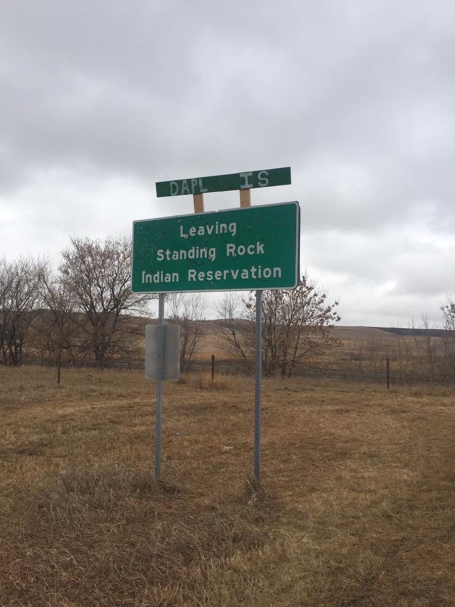 Highway sign leaving Standing Rock Reservation (Photo by Kolby KickingWoman)