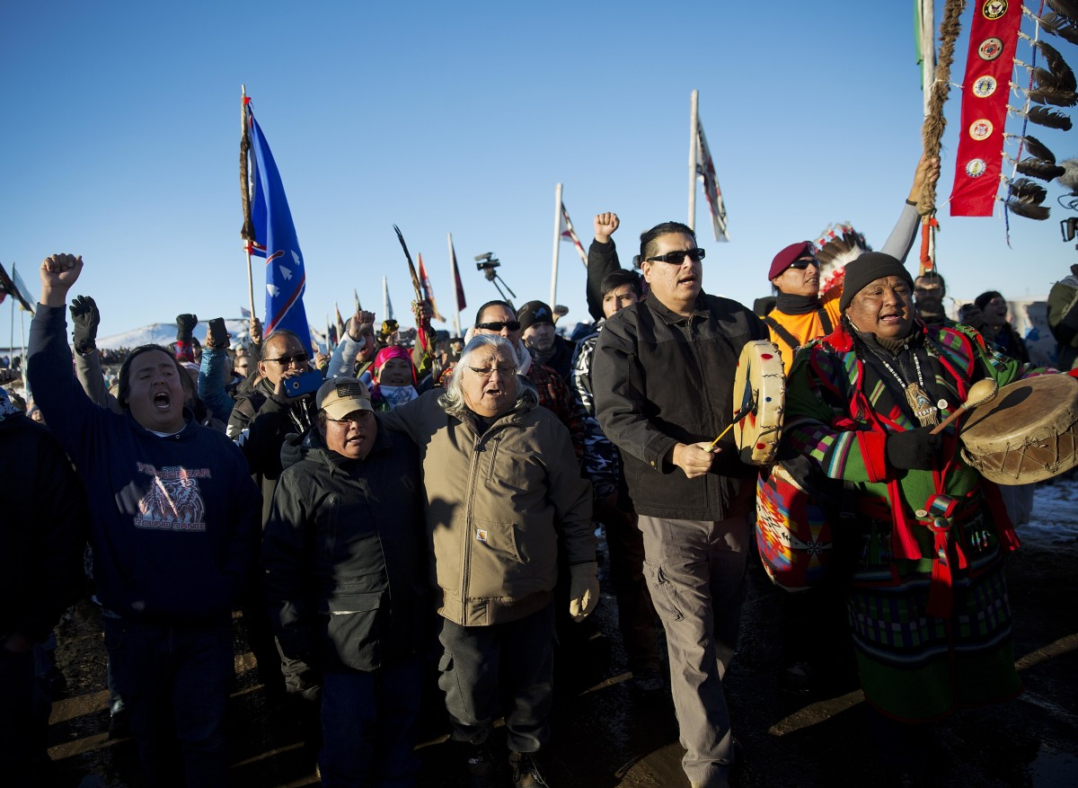 In this Dec. 4, 2016 file photo, protesters march at Oceti Sakowin camp where people have gathered to protest the Dakota Access oil pipeline in Cannon Ball, N.D. It has been called the largest gathering of Native American tribes in a century. Tribal members and others have joined in an ongoing, tense protest against the $3.8 billion Dakota Access oil pipeline, which the Standing Rock Sioux believes threatens sacred sites and a river that provides drinking water for millions of people. The protest is included in the AP top news stories in North Dakota this year. (AP Photo/David Goldman, File)