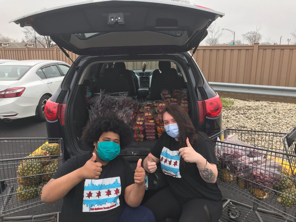 Two youth with the Chicago American Indian Center, a grantee, buying food for distribution.