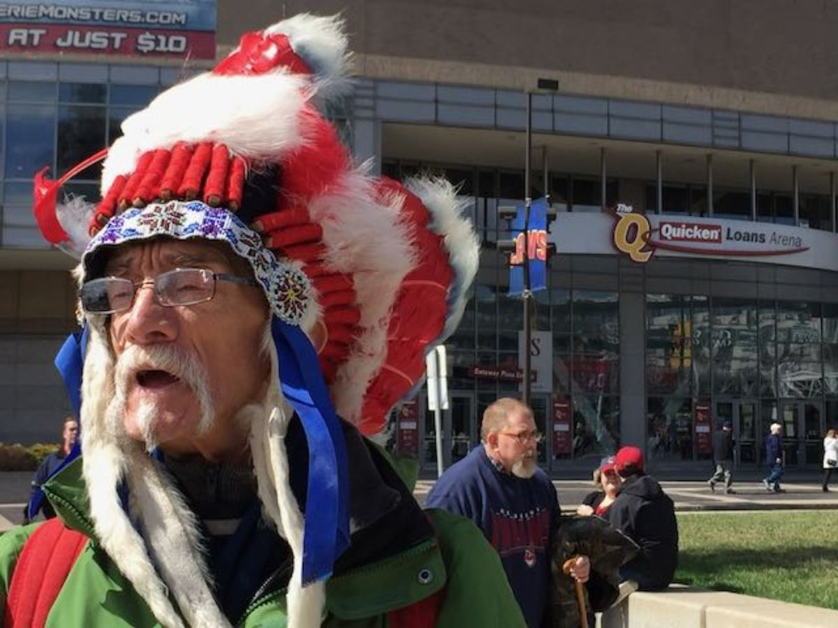 John Britain, a fan of the Cleveland Indians, dons a headdress during opening day. Britain says he is one quarter Apache and that he purchased the headdress on the Navajo reservation in New Mexico. File photo by Mary Annette Pember