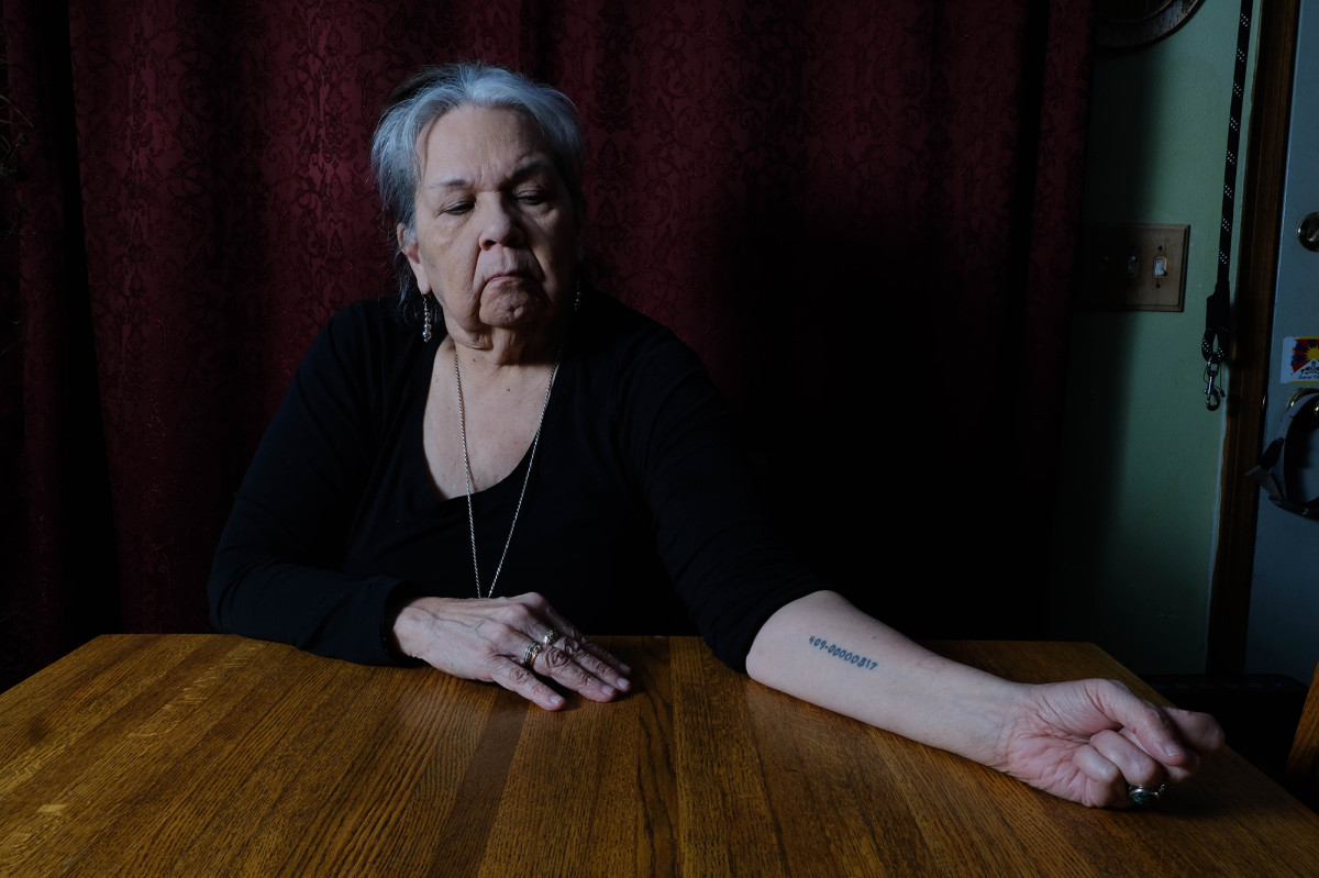 Jody Beaulieu, 70, displays a tattoo of her tribal enrollment number-issued by the federal government-to call attention to the colonial construct of measuring tribal enrollment. (Photo by Mary Annette Pember)