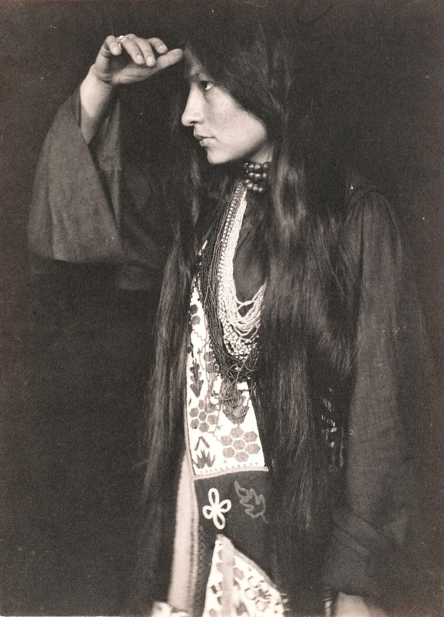"""Lakota author and activist Zitkála-Šá pictured in 1898. As a girl, she was forcibly sheared. As an adult, she wrote of the experience: """"I cried aloud, shaking my head all the while until I felt the cold blades of the scissors against my neck, and heard them gnaw off one of my thick braids. Then I lost my spirit...now I was only one of many little animals driven by a herder."""" (Photo courtesy of Smithsonian)"""