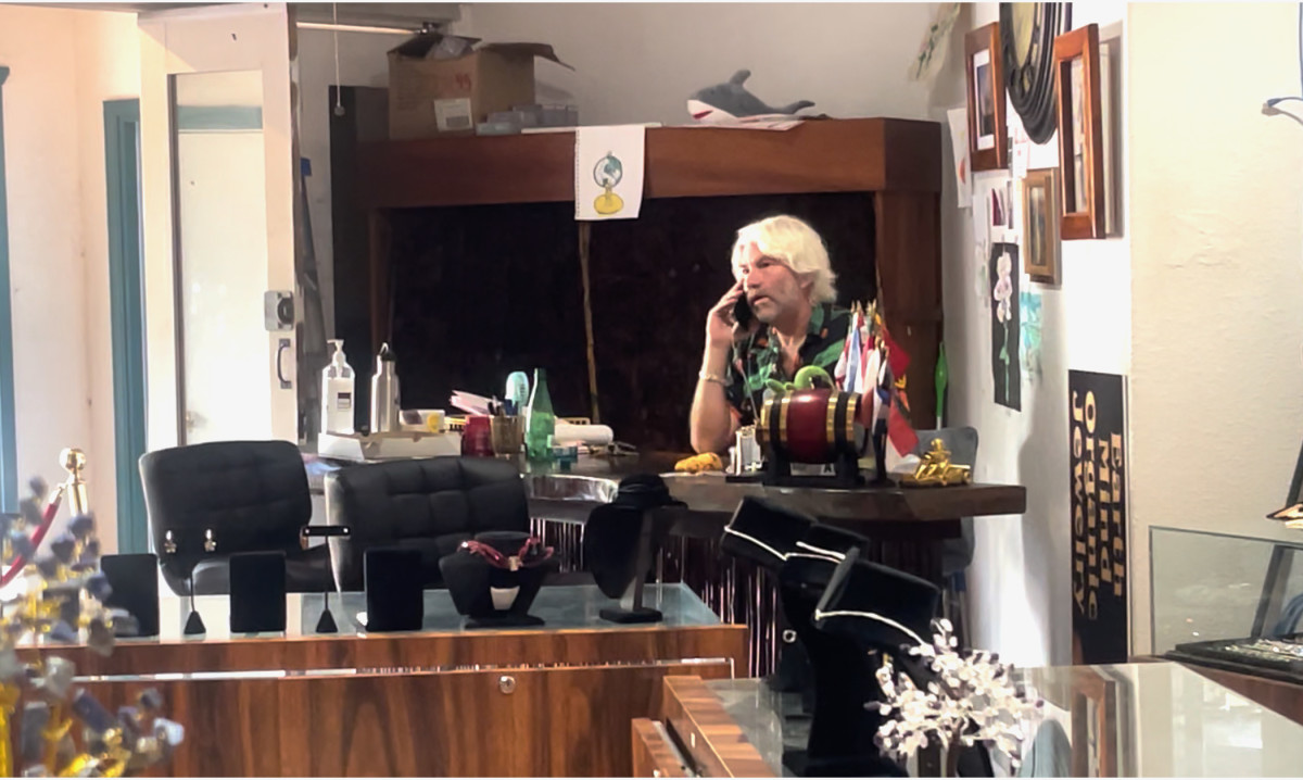 James Bond, of EAD Enterprises, LLC, in his jewelry store at the Kona Inn Shopping Village on Ali'i Drive, Kailua-Kona, Hawai'i. Bond is going out of business after the governor asked visitors to delay visits until the end of October. Sept. 21, 2021 (still from video by Laurence A. Goldin).