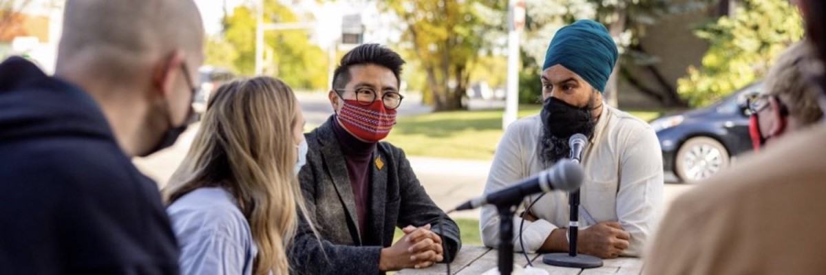 """Blake Desjarlais, 27, with red mask, ran for the Canadian Parliament as a New Democratic Party candidate, winning election in a traditionally conservative district in the middle of Alberta's oil country. Desjarlais is Indigenous, two-spirited and openly declares himself a """"climate champion."""" (Photo courtesy of the New Democratic Party)"""