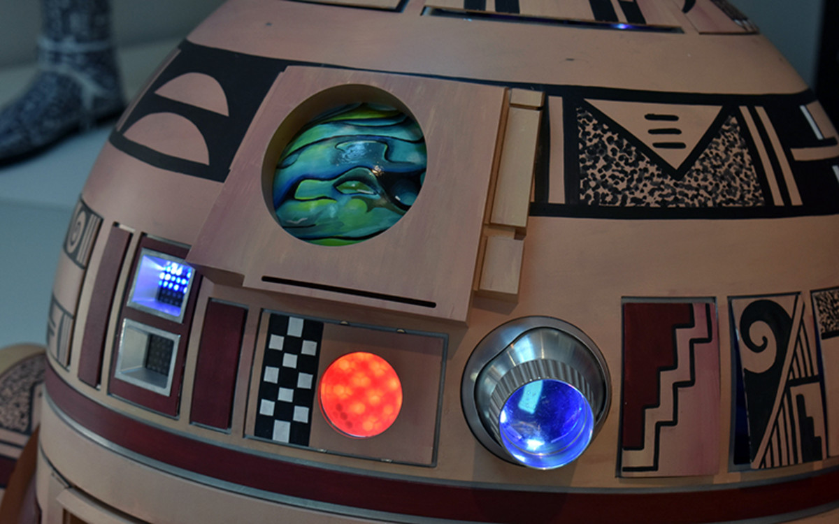 """Indigenous artists created works for """"The Force Is With Our People"""" exhibit in Flagstaff, such as this working Hopi R2 by Duane Koyawena, Hopi-Tewa, and Joe Mastroianni. (Photo by Kelly Richmond/Cronkite News)"""