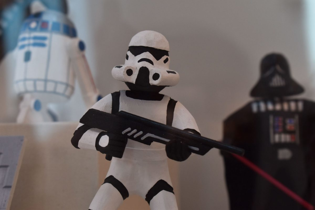 """Virgil Wood carved this Diné-style stormtrooper for the exhibit """"The Force Is With Our People."""" (Photo by Kelly Richmond/Cronkite News)"""