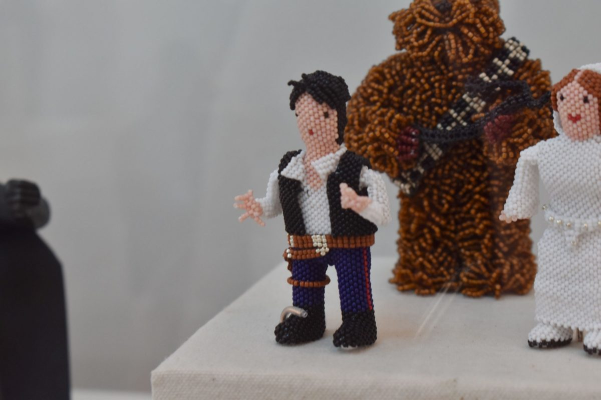 Han Solo, Chewbacca and Princess Leia were created by Farlan and Alesia Quetawki in Zuni styled beadwork. (Photo by Kelly Richmond/Cronkite News)