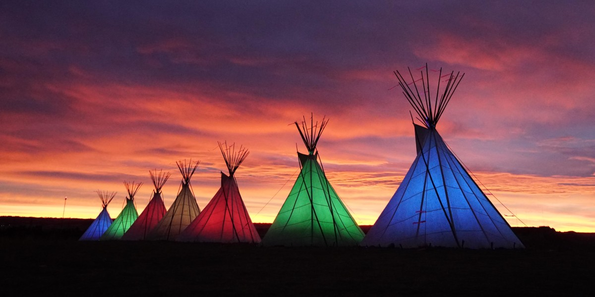 Pictured: Seven teepees will illuminate the horizon on Peets Hill in Bozeman, Montana from October 8 to 18 in celebration of Indigenous Peoples Day 2021.