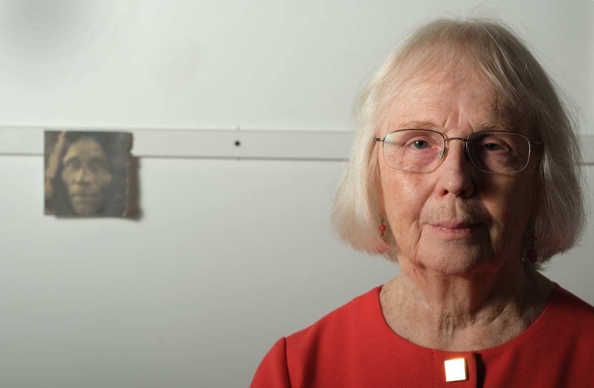 Jodine Grundy in her Cincinnati, OH studio in September 2021. Grundy taught at St. Mary's Catholic Indian Boarding School on the Colville reservation from 1966-67 until bad dreams and feelings caused her to resign. She has kept the photo behind her of an unknown Indigenous man since her days at the school. (Photo by Mary Annette Pember, Indian Country Today)