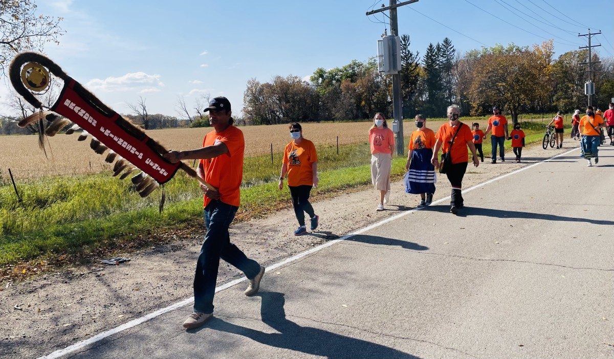 A week-long celebration of the Day of Truth and Reconciliation on Sept. 30, 2021 in Brandon, Manitoba, Canada, included a walk from the Riverbank Discovery Center to the Brandon Indian Residential School site to honor those who suffered in residential schools. The day, originally known as Orange Shirt Day, is now a national holiday in Canada. The U.S. celebrates Sept. 30 as a Day of Remembrance. (Photo by Dannielle Morrisseau for Indian Country Today)