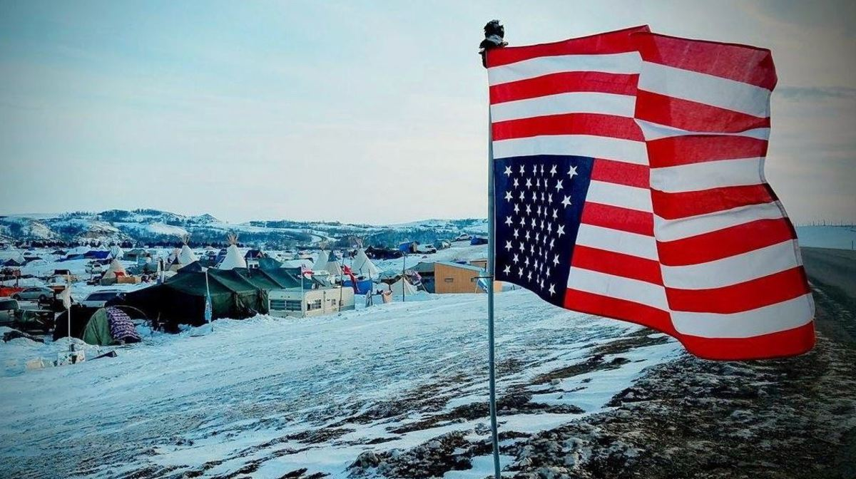 """A flag in distress at the camp in Standing Rock featured in """"End of the Line: The Women of Standing Rock,"""" directed and produced by Shannon Kring and co-produced by Pearl Daniel Means. (Courtesy image)"""