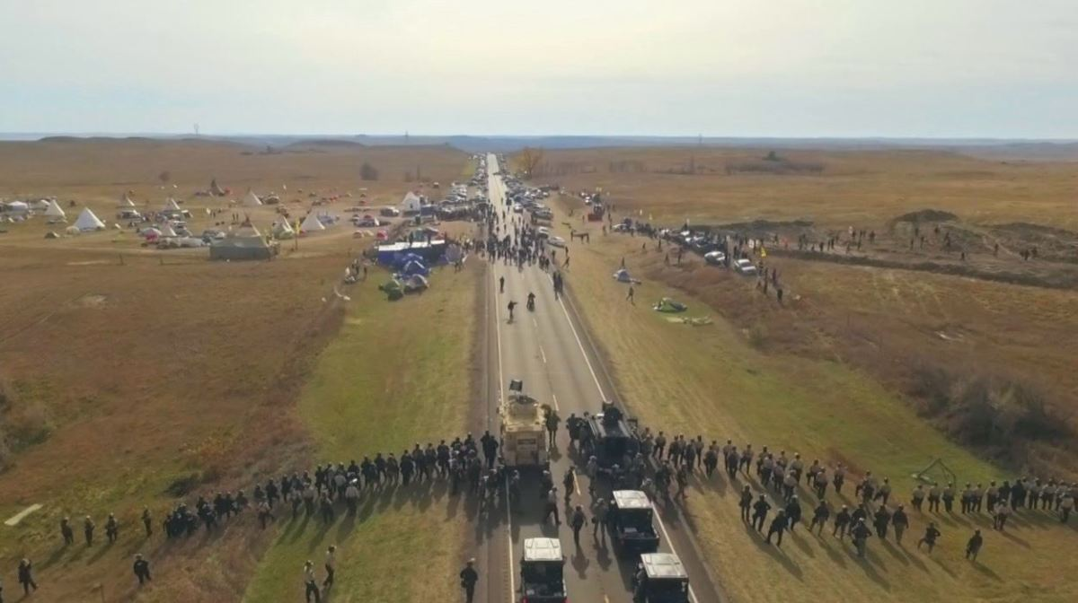 An overhead drone shot of the interactions at Standing Rock shot by the late Native journalist Myron Dewey