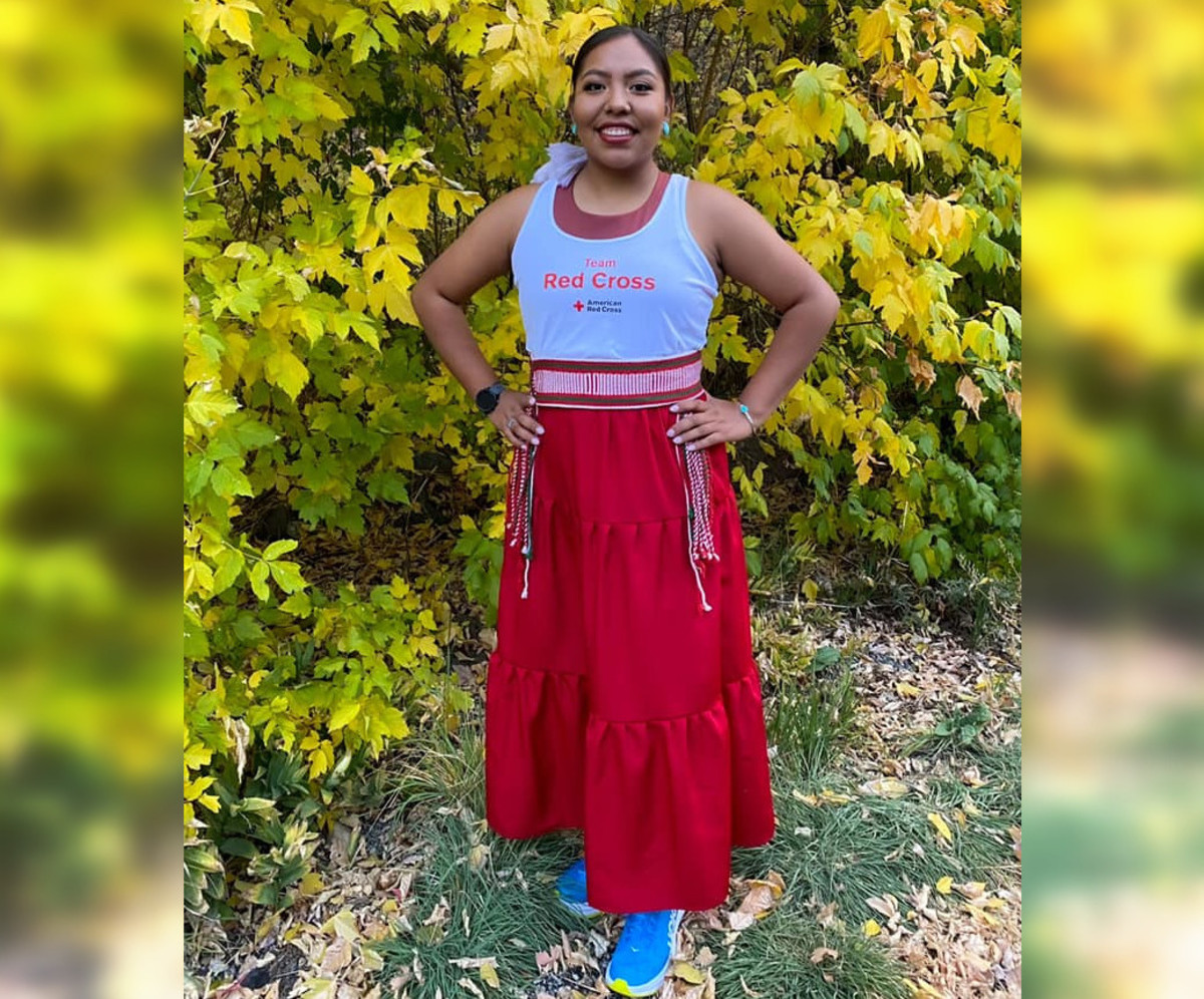 25-year-old Erin Tapahe, Diné, in her running shoes and traditional Navajo attire.(Photo courtesy of Eugene Tapahe)