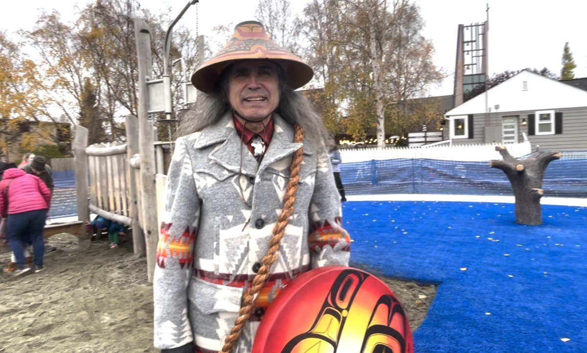 Mark Haldane, Tsimpshian, wore regalia to honor the cultural Dena'ina Athabascan cultural theme in a renovated playground in downtown Anchorage. Oct. 11, 2021 (Photo from video by Joaqlin Estus).