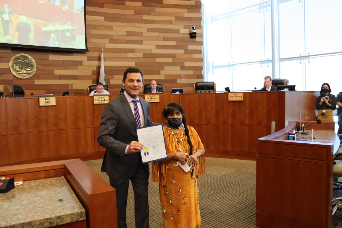"""Pictured: Mildred Burley, a tribal elder with the California Valley Miwok Tribe, accepted the official proclamation from the San Joaquin County Board of Supervisors, which proclaimed October 12, 2021 as """"Indigenous People's Day"""" in San Joaquin County on behalf of the tribe and """"all native people that live in California."""