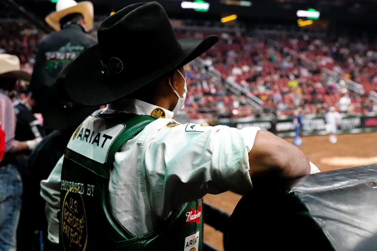 Whitehorse watches the arena before his Round One ride on Cali's Chrome. (Photo by Marlee Smith/Cronkite News)
