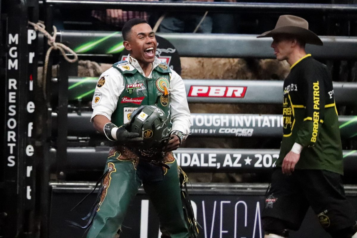 Keyshawn Whitehorse yells and smiles after a 90.25 ride in the final round to secure his first event win of 2021. (Photo by Marlee Smith/Cronkite News)