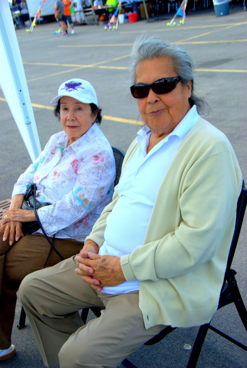 Two elder spectators at the Saint Regis Mohawk Tribe's Annual Ironworkers competition in Akwesasne, New York sit back and enjoy the fun. (Vincent Schilling)