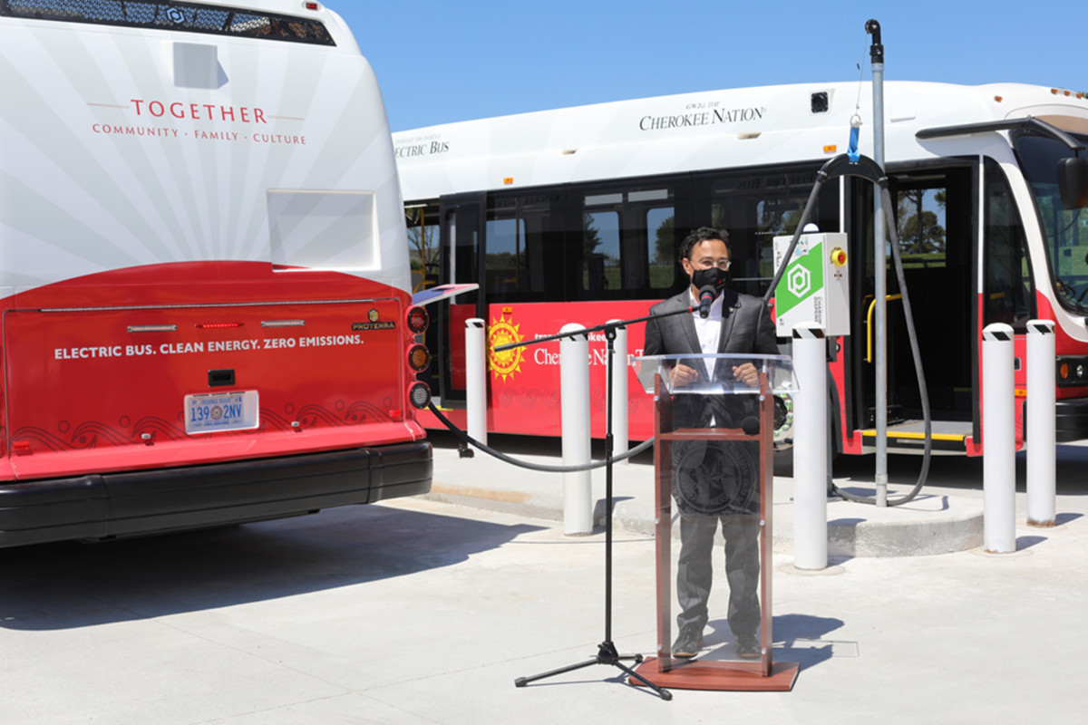 Pictured: Principal Chief Chuck Hoskin Jr. announces the tribe's first two rural, eco-friendly electric transit buses and the first electric school bus for Sequoyah High School.