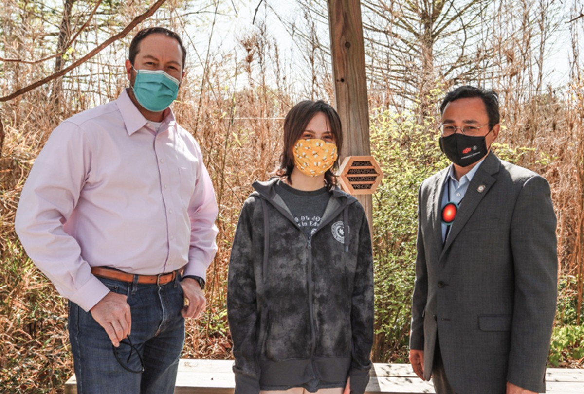 Pictured (L-R): Cherokee Nation Deputy Principal Chief Bryan Warner, Jazzy Hoskin, Principal Chief Chuck Hoskin Jr. checking one of two new pollinator houses provided to the Cherokee Nation by The Bee Conservancy.