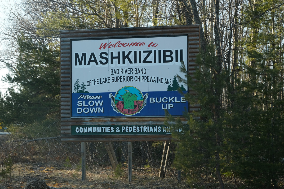A sign welcomes people to Mashkiiziibii, Medicine River, on the Bad River Band of Lake Superior Chippewa Indians reservation in Wisconsin. (Photo by Mary Annette Pember)