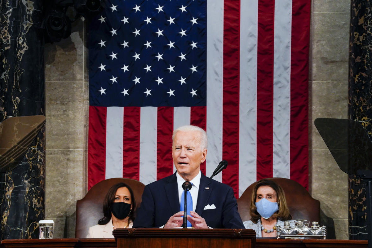 President Joe Biden addresses a joint session of Congress, Wednesday, April 28, 2021, in the House Chamber at the U.S. Capitol in Washington, as Vice President Kamala Harris, left, and House Speaker Nancy Pelosi of Calif., look on. (Melina Mara/The Washington Post via AP, Pool)