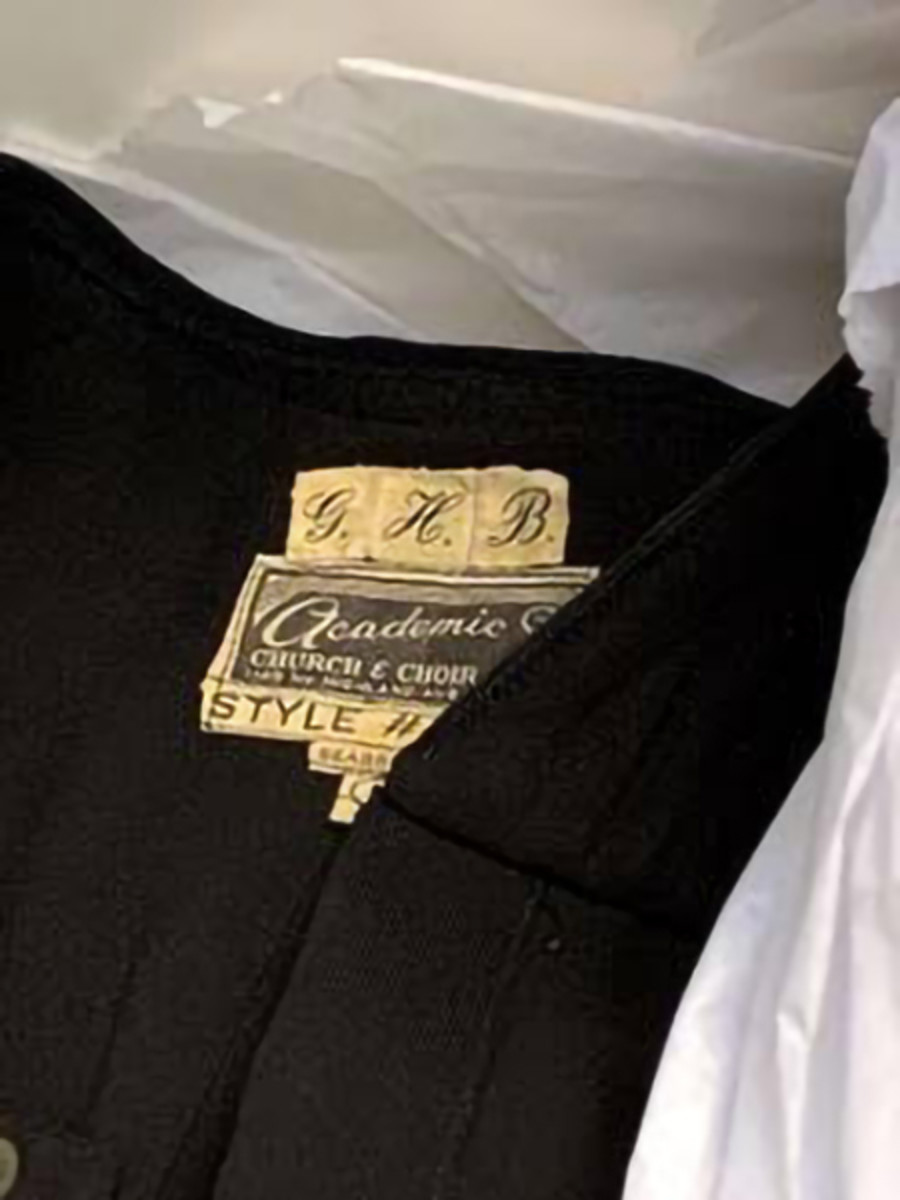 Pictured: Closeup of Judge Boldt's monogrammed initials on the tag in his judicial robe. Archival paper in an archival box will protect and preserve the garment. George Hugo Edward Boldt was named for his father's dearly beloved brothers. The children of Danish immigrants, and having lost their mother as young children, the Boldt brothers were extremely close. Judge Boldt often spoke of himself using all three names.