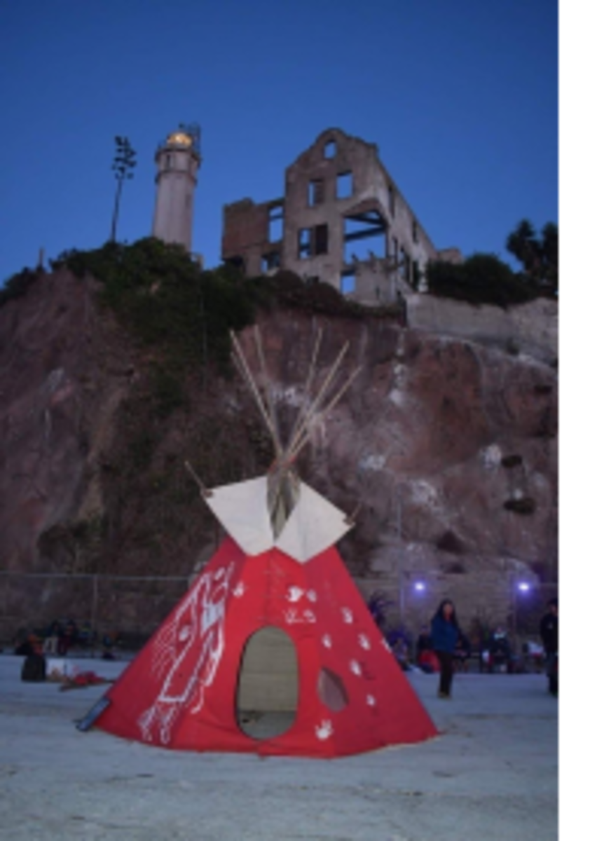 """Pictured: """"MMIW&P of California"""" is gifting a red tipi to the Bemidji MMIW 218 group."""