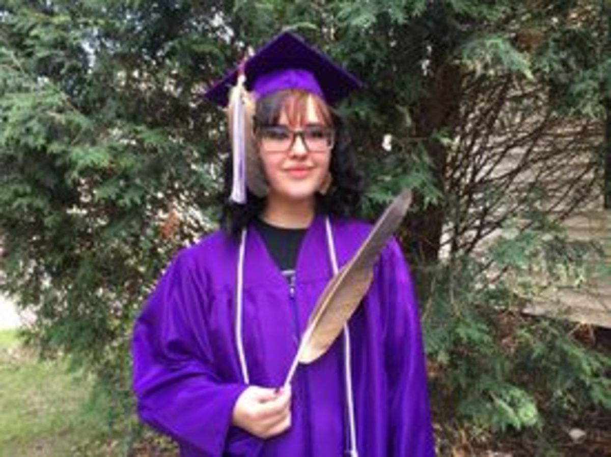 Maya Fairbanks in her cap and eagle feather she is wearing for graduation at Cloquet high school. (Photo courtesy Sheila Lamb)