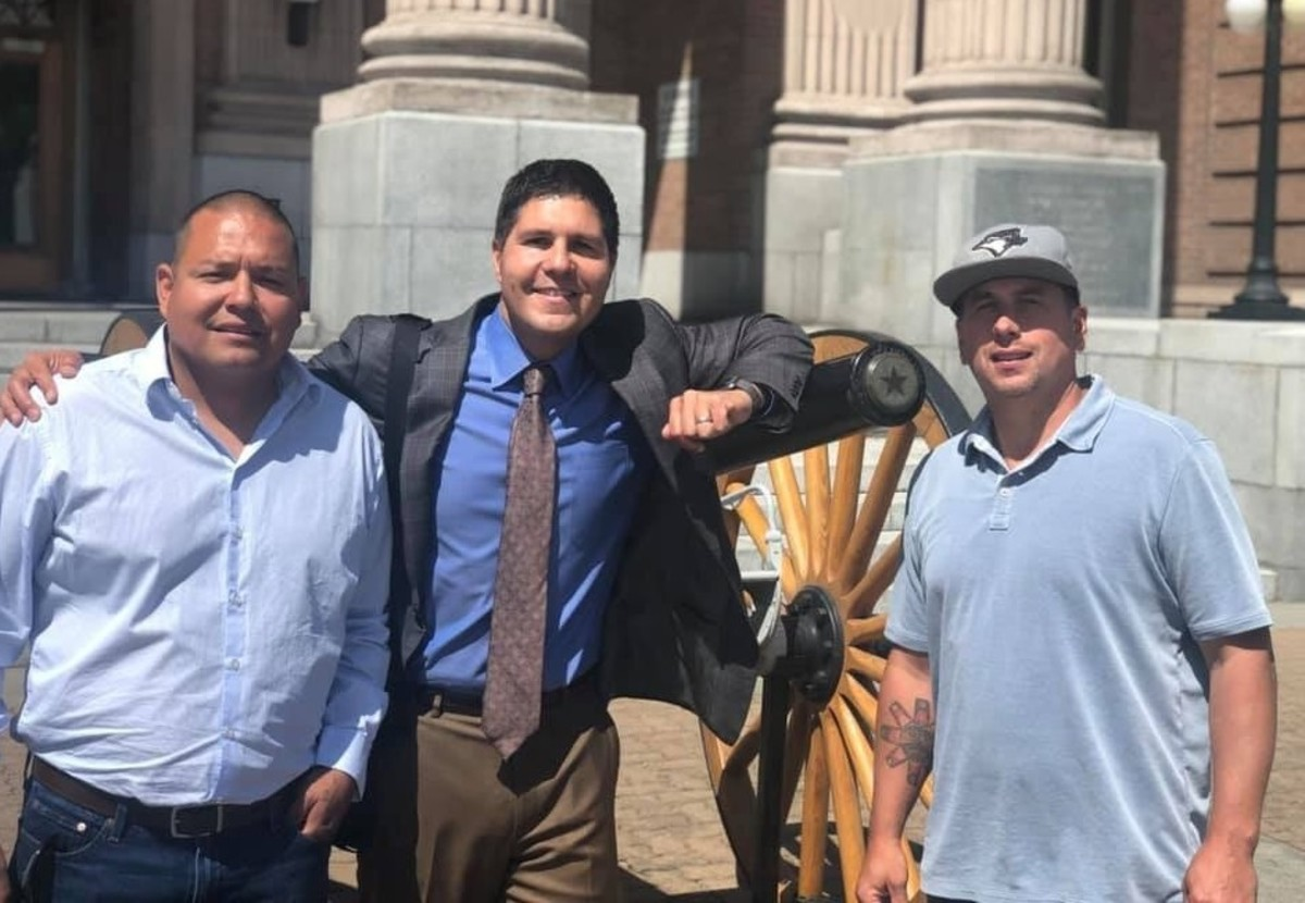 Tulalip fish buyers Hazen Shopbell (left) and Anthony Paul (right) stand outside the Skagit County Superior Court in 2019 with their attorney Gabe Galanda. The Washington Department of Fish and Wildlife agreed to settle out of court with the men in April 2021 over their claim they were falsely arrested.