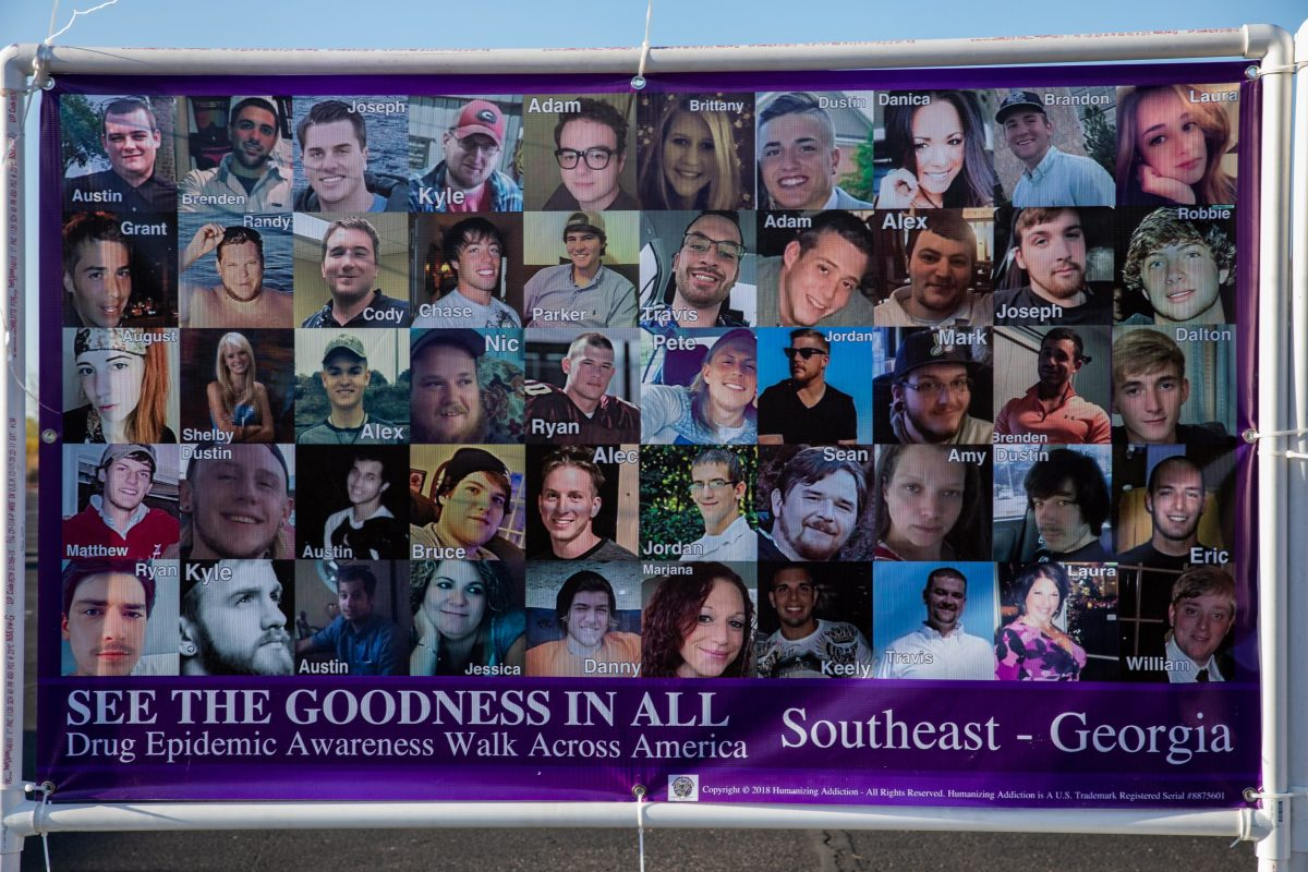 A poster displayed at an event in Gilbert, Ariz., on March 31, 2021, shows the names and faces of those who've lost their lives to drugs. Federal statistics show about 87,000 people died from drug overdoses in the 12 months ending in September 2020. (Photo by Alberto Mariani/Cronkite News)