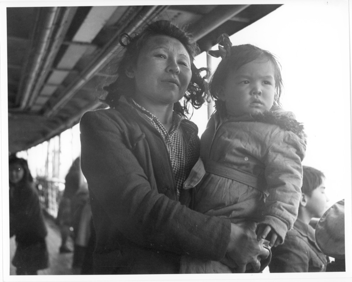 """Unangan, WWII, Funter Bay. Mother and daughter. Image titled """"nara_207247_m"""": National Archives and Records Administration, NARA-207247-M (JE Note: Photo of Aleuts (Unangan) being transported from Pribilof and Aleutian islands to camps in SE Alaska during WWII. Presumably this is aboard the USAT Delarof)."""