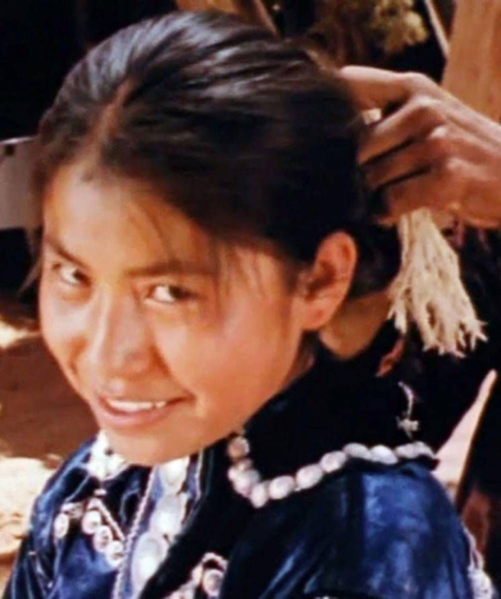 A young Elsie Mae Begay smiles at the camera. (Courtesy Jeff Spitz)