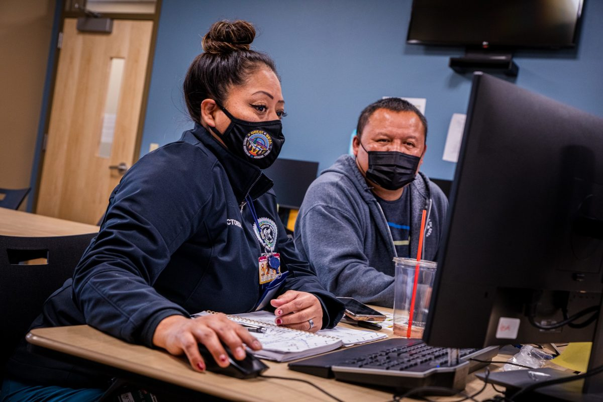 Victoria Moses, an Indian Health Service contact tracer, checks the progress of patients before heading out into the field for home visits in Whiteriver, Ariz. on Feb. 17, 2021. (Photo by Alberto Mariani/Cronkite News)