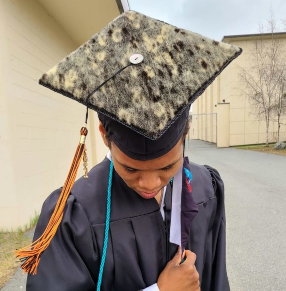 Ayyu Qassataq's son, David Paoli graduated from West High School. He was not allowed to wear his sealskin graduation cap, instead he was forced to wear a standard graduation cap. (Courtesy Ayyu Qassataq)