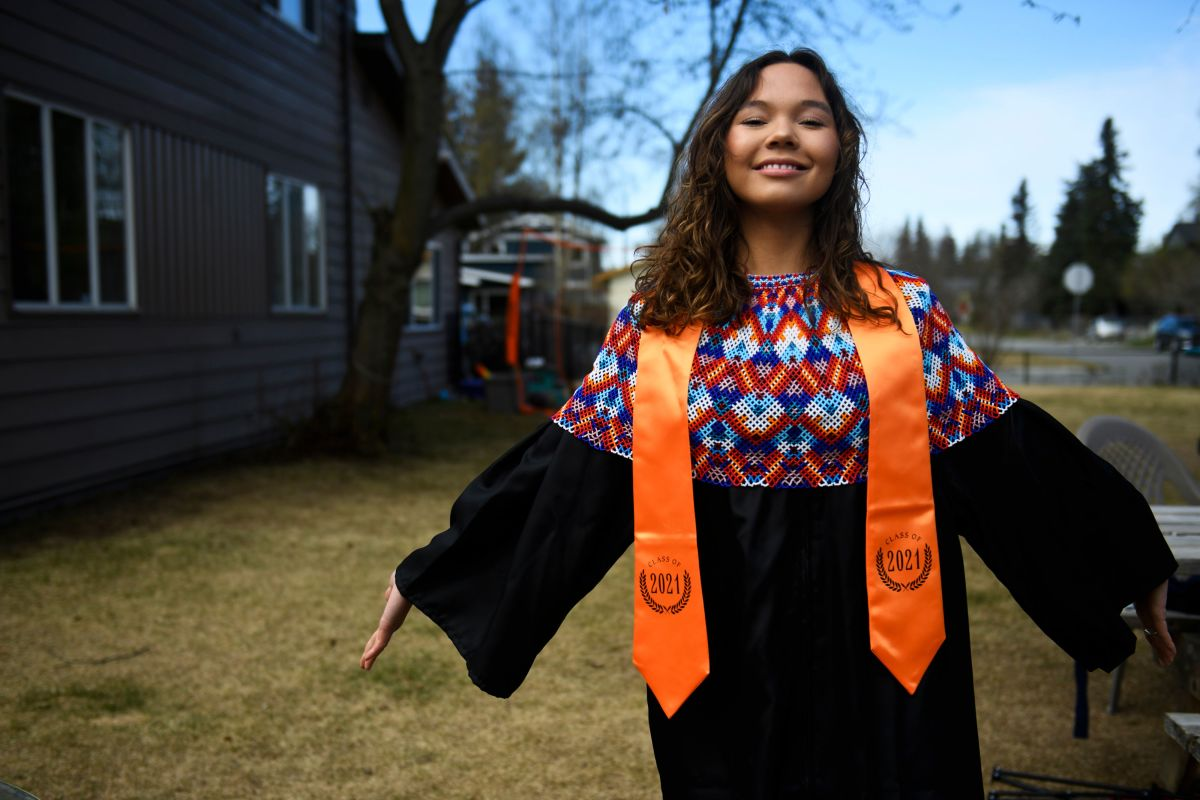 Ivalu Blanchett decided not to attend the West High School graduation after she was told she couldn't wear her Greenlandic shawl over her gown. Instead, she had a private graduation ceremony in her yard. Photographed on May 12, 2021. (Marc Lester / Anchorage Daily News)