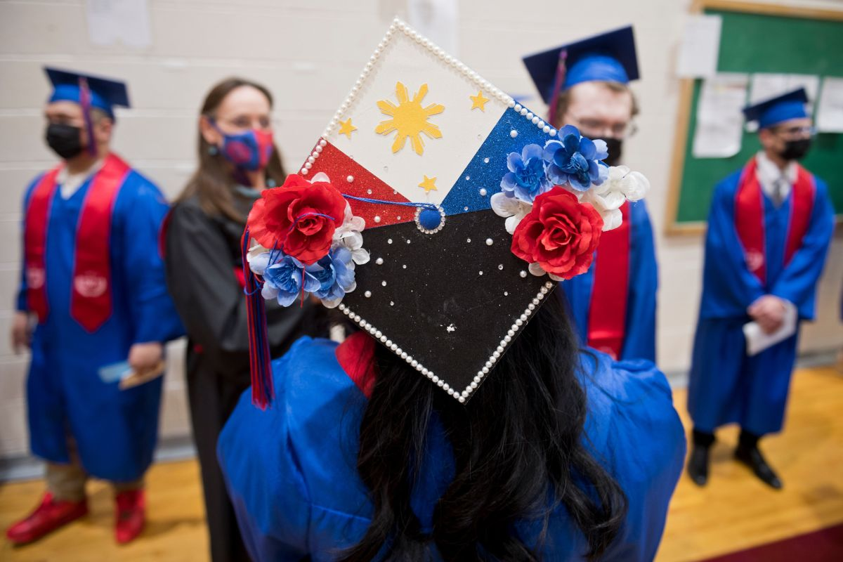 Graduating East High School student Melrose Meneses incorporated elements of the flag of the Philippines on her cap. (Marc Lester / Anchorage Daily News)