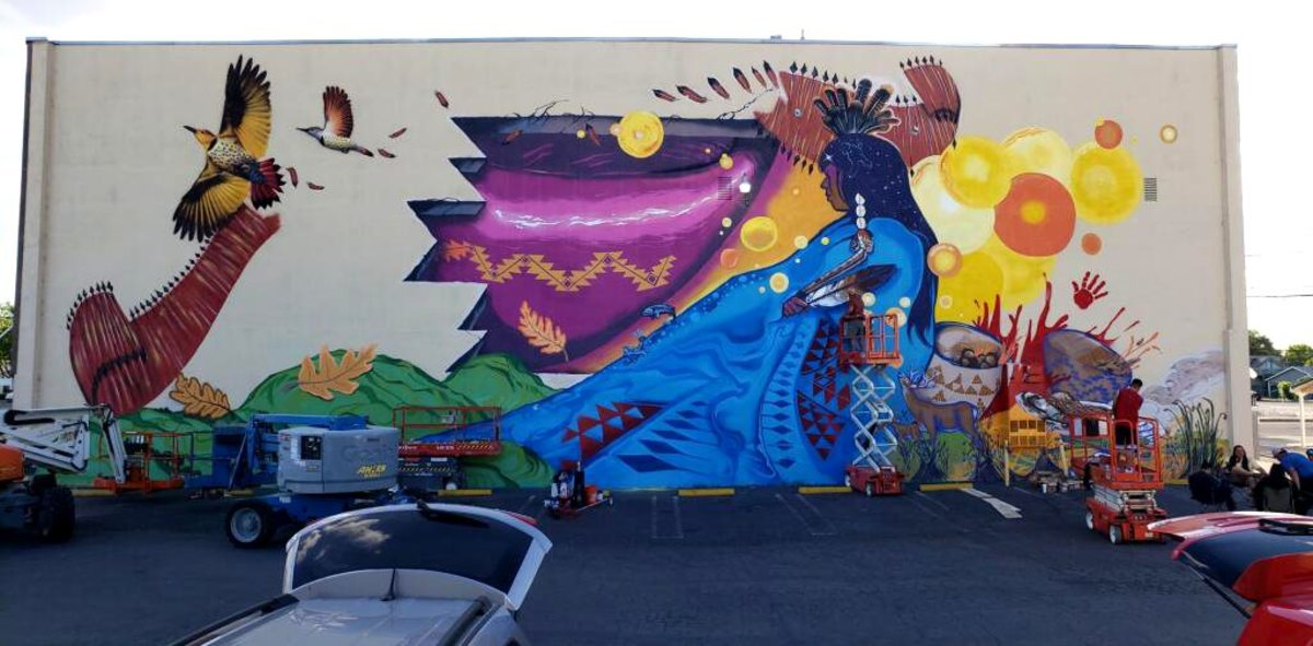Pictured: One of two new murals in Corning, California depicting Paskenta Band of Nomlaki Indians culture.