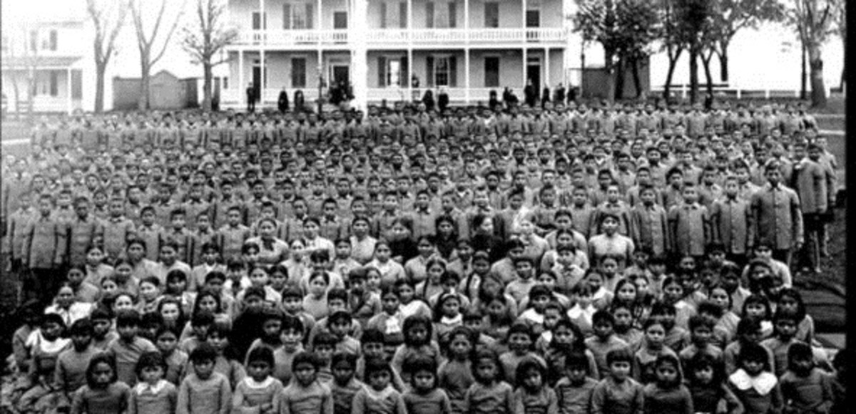 This photo from about 1900 shows pupils at the Carlisle Indian Industrial School in Pennsylvania. The school helped shape policies for Indian boarding schools in the United States and Canada. (Photo courtesy of the Carlisle Indian School Digital Resource Center)