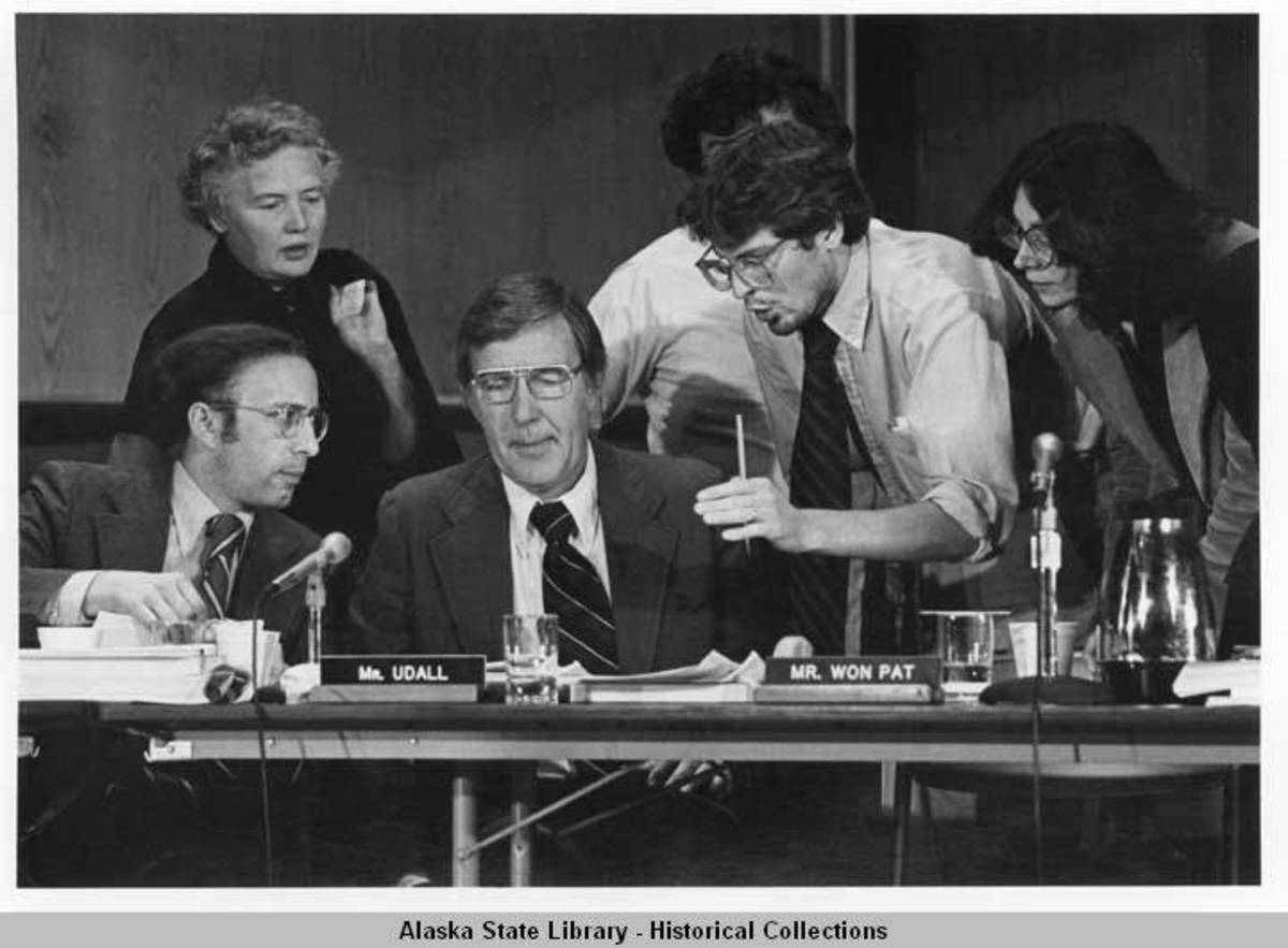Congressman Udall, surrounded by aids vying for his attention at a land claims hearing. (Photo courtesy of the Alaska State Library).